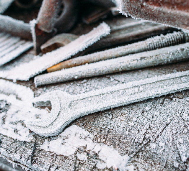 frozen construction tools outdoors
