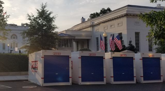 PODS containers at white house renovation at sunset